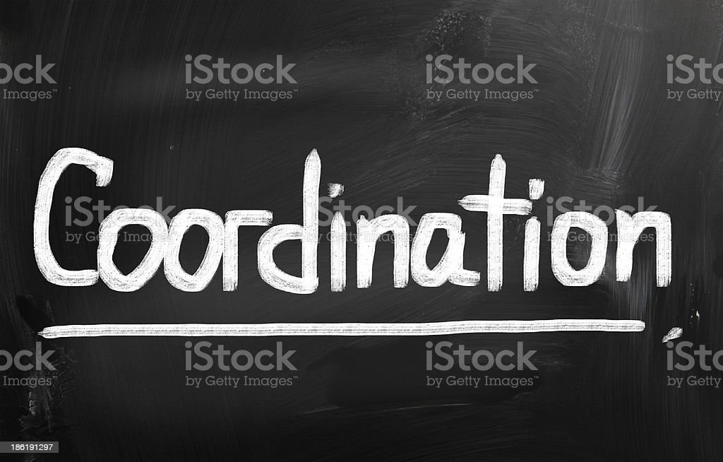 The word coordination written on a chalkboard stock photo