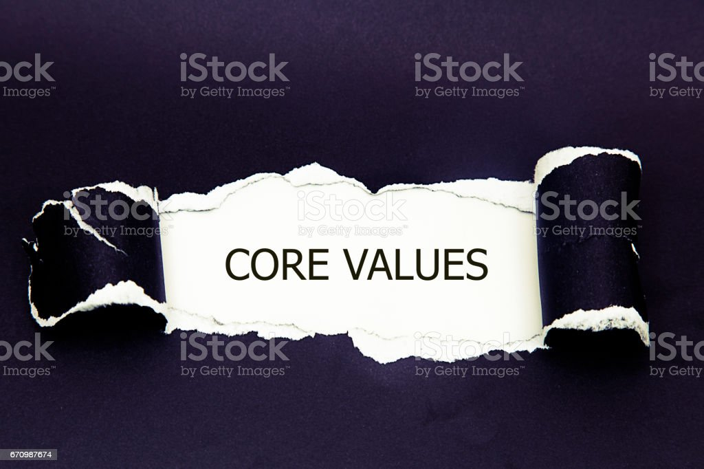 The word Core Values appearing behind torn paper. stock photo