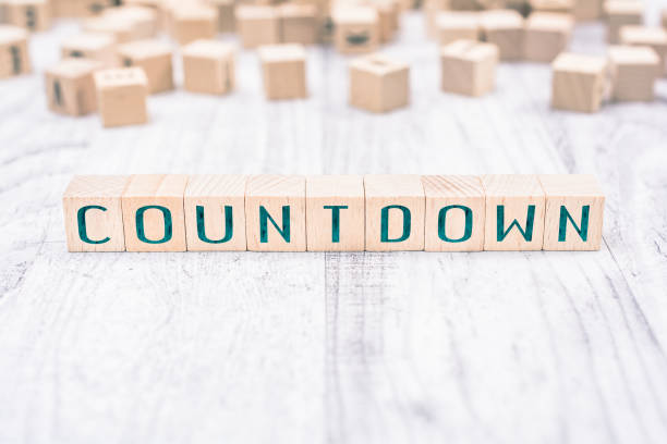 the word countdown formed by wooden blocks on a white table, reminder concept - countdown stock photos and pictures