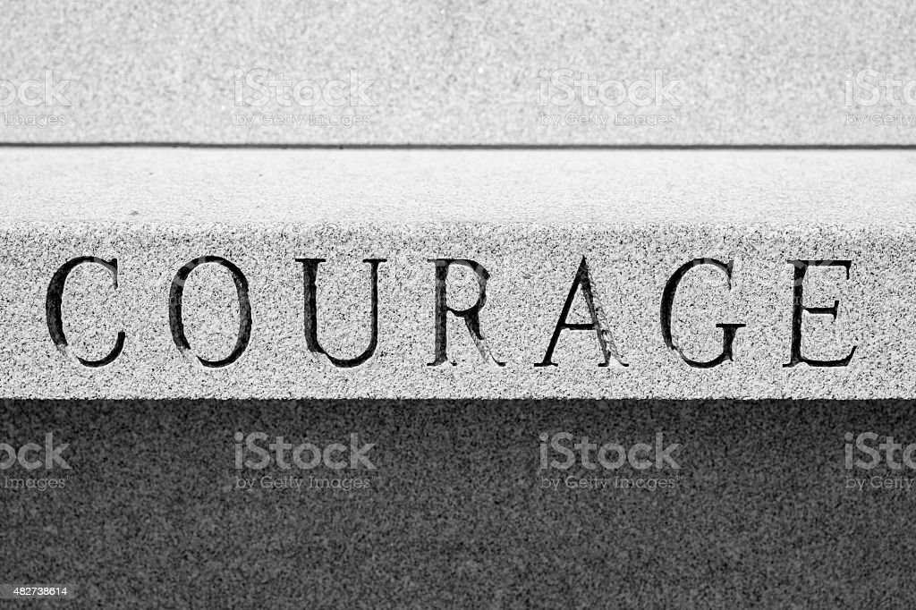 The Word COURAGE, Chiseled In Stone, Black and White stock photo