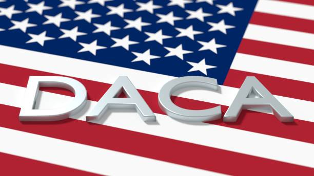 The word daca on an american flag immigration concept stock photo