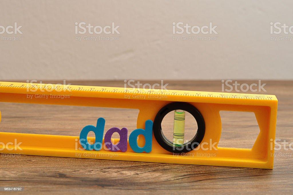The word dad displayed with a level - Zbiór zdjęć royalty-free (Bańka)
