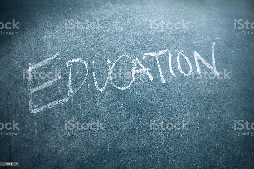 The word education written on a blackboard royalty-free stock photo