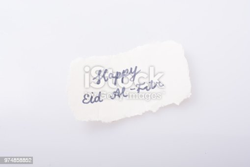 istock the word EID EL FITR  written on torn paper 974858852