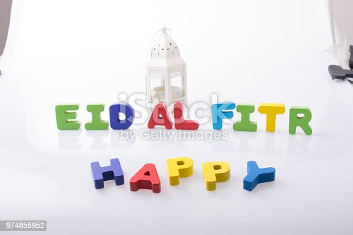 istock the word EID EL FITR  written with colorful letters 974858952