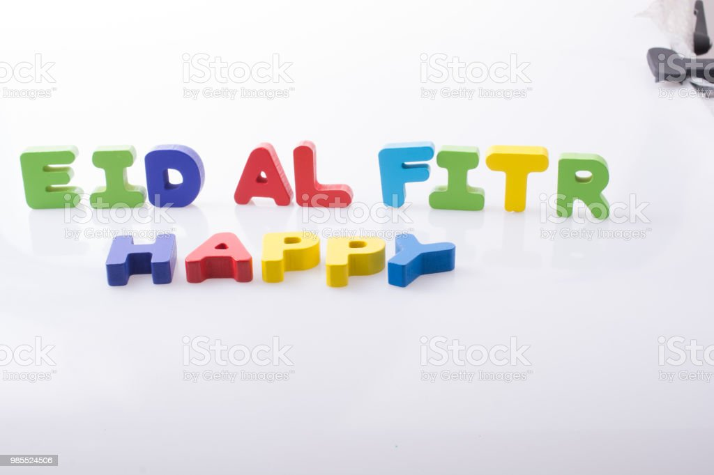 the word EID EL FITR  written with colorful letters stock photo