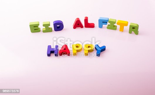 istock the word EID EL FITR  written with colorful letters 989573376