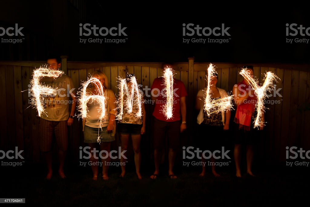 The word Family in sparklers time lapse photography The word Family in sparklers time lapse photography Celebration Stock Photo