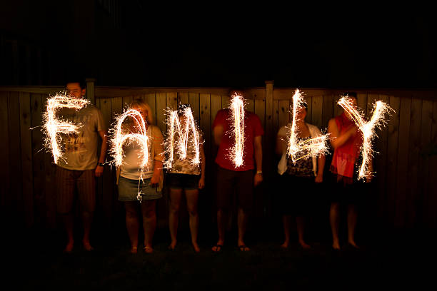 The word Family in sparklers time lapse photography stock photo