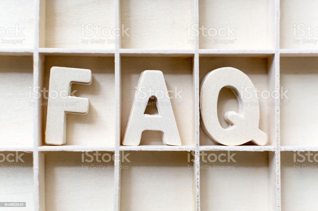 The word FAQ wood in slot, Frequently asked questions stock photo