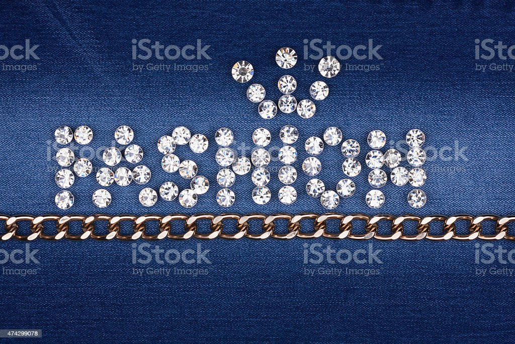 The word 'fashion' made by ​​with rhinestones and gold chain stock photo