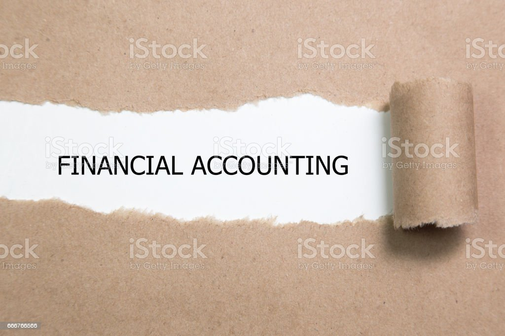The word FINANCIAL ACCOUNTING appearing behind torn paper. foto stock royalty-free