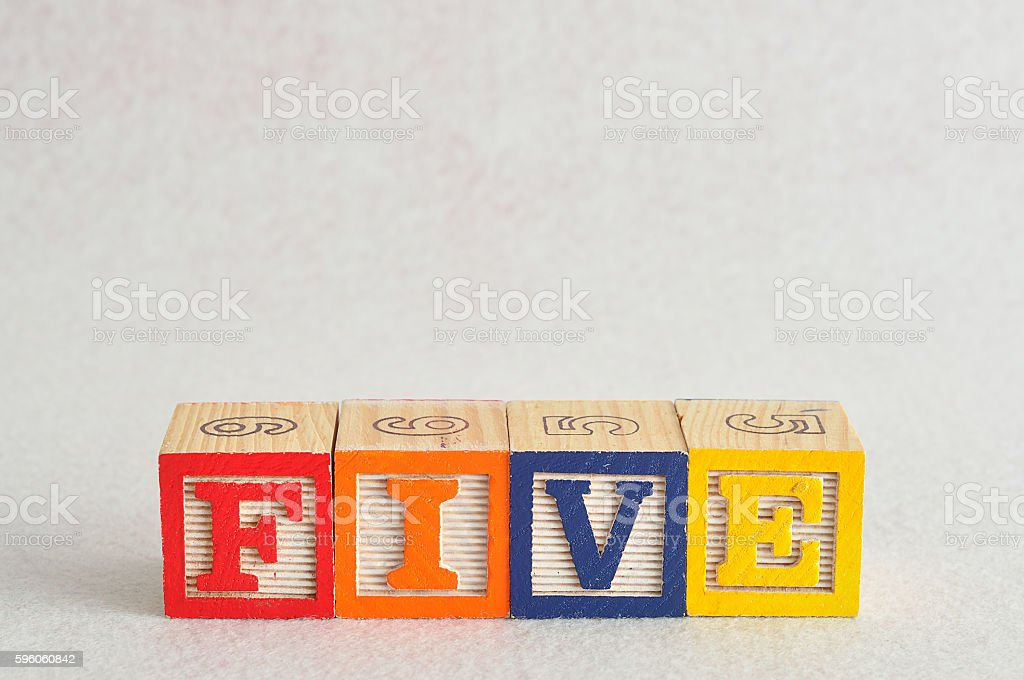 The word five (5) spelled with colorful alphabet blocks royalty-free stock photo