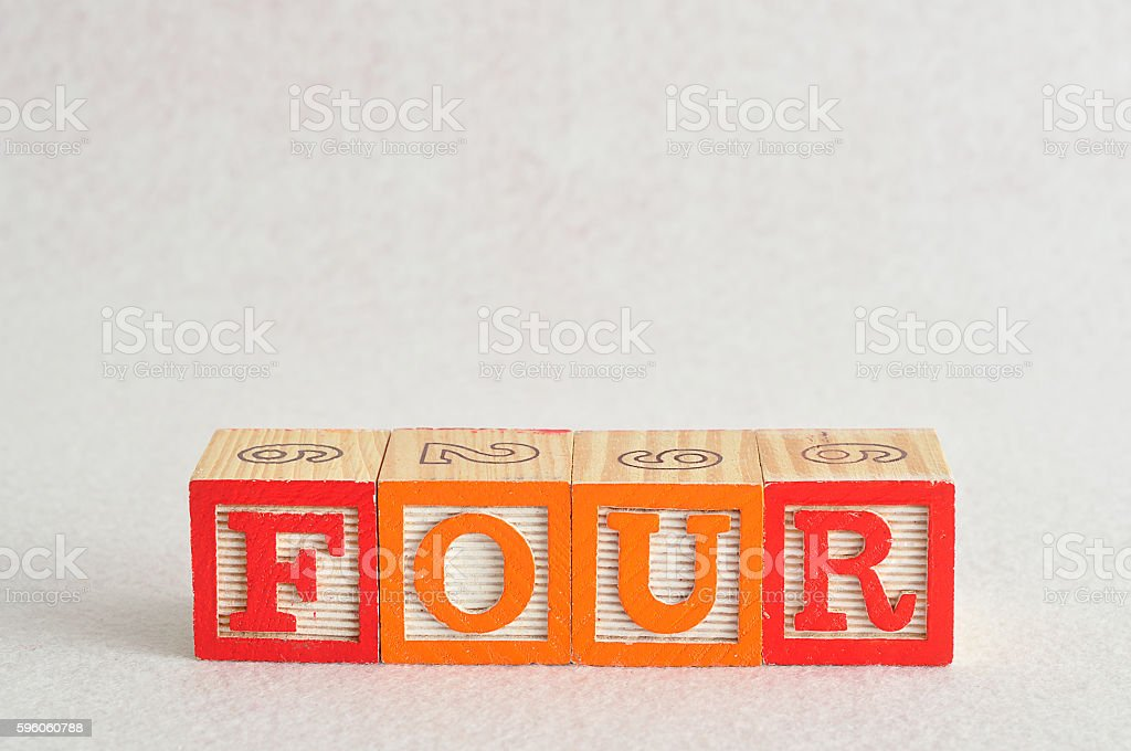The word four (4) spelled with colorful alphabet blocks royalty-free stock photo