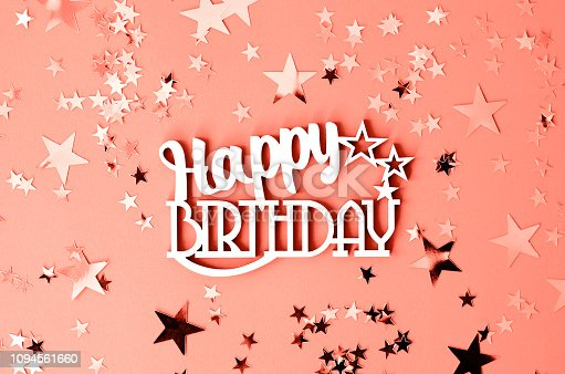 istock The word happy birthday on a background of coral color with stars. 1094561660