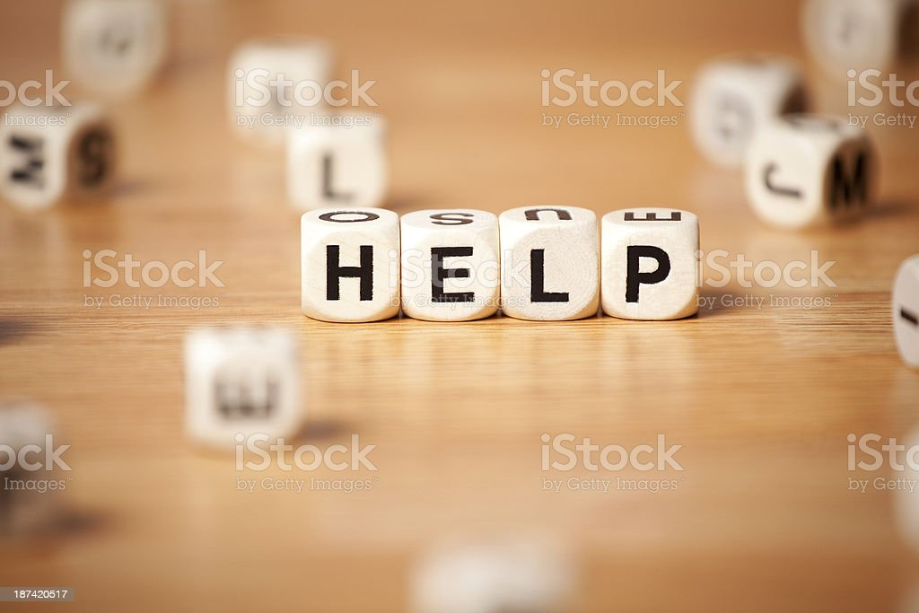 The Word Help Spelled In Letter Cubes royalty-free stock photo