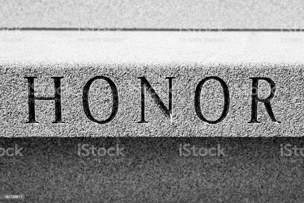 The Word HONOR, Chiseled In Stone, Black and White stock photo