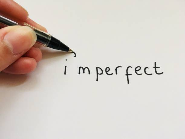 The word imperfect being wrote with an apostrophe to spell I'm perfect The word imperfect being wrote with an apostrophe to spell I'm perfect apostrophe stock pictures, royalty-free photos & images