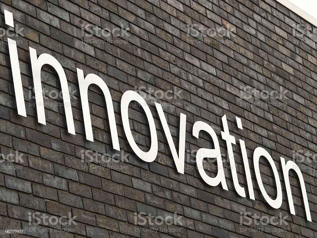 The word innovation on brick wall royalty-free stock photo