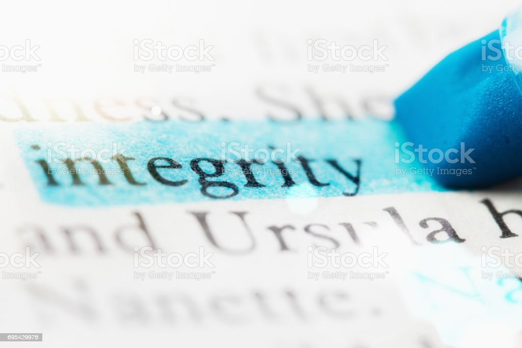 The word 'integrity' highlighted on defocused printed page stock photo