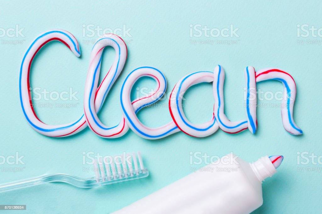 The word is clean from the toothpaste. Tube and toothbrush for cleaning teeth stock photo