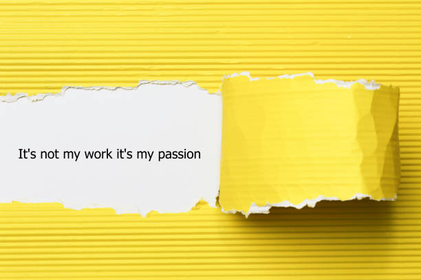 The word It's not my work it's my passion appearing behind torn paper. stock photo