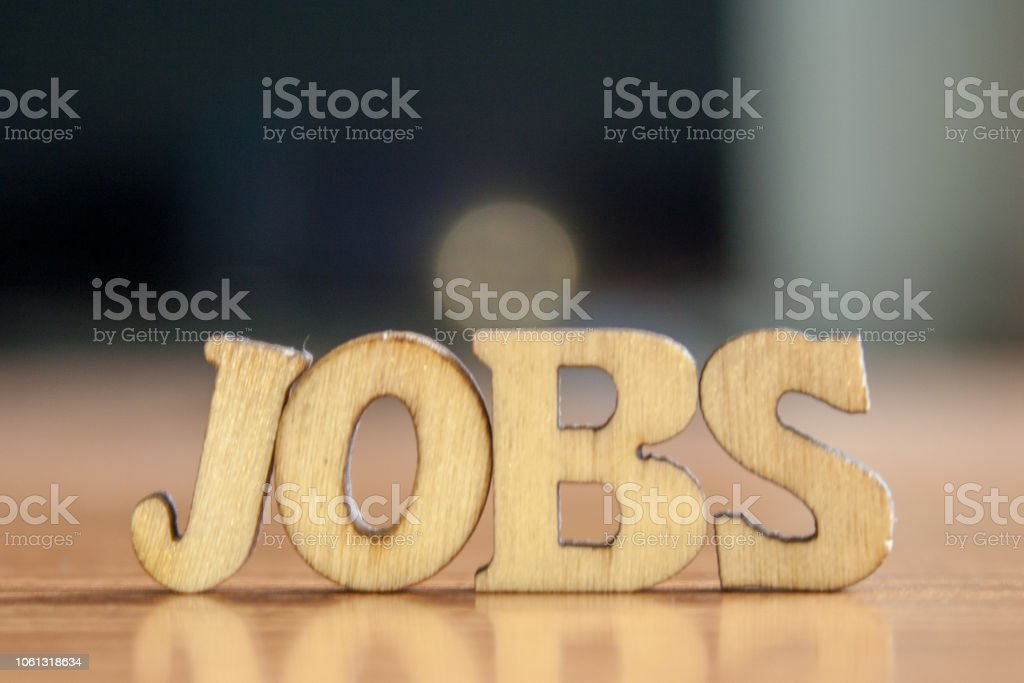 The word 'jobs' made of wooden letters. wood inscription on table stock photo