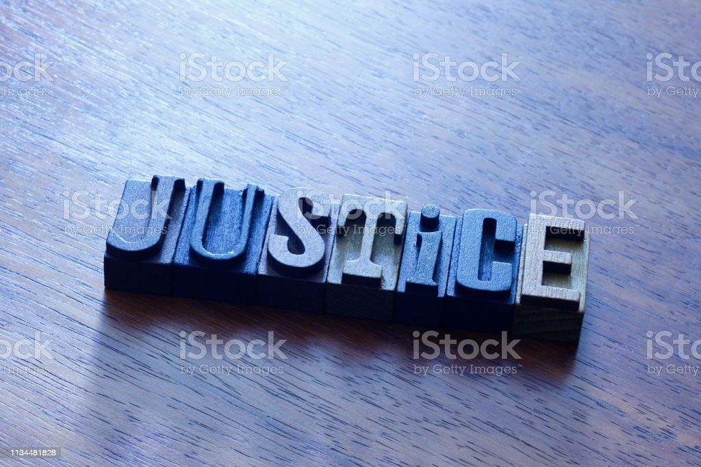 The Word Justice Spelled Out In Antique Wooden Block Letters stock photo