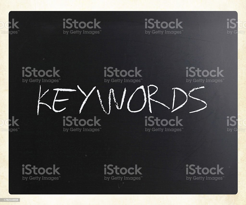 The word 'Keywords' handwritten with white chalk on a blackboard royalty-free stock photo