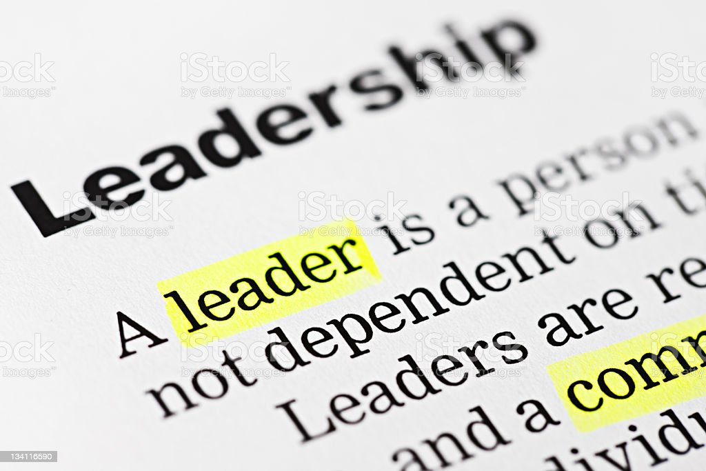 The word 'leader' is highlighted in yellow on a document royalty-free stock photo