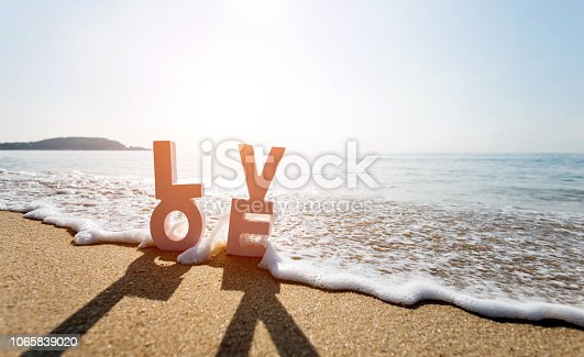 istock The word love on the beach 1065839020
