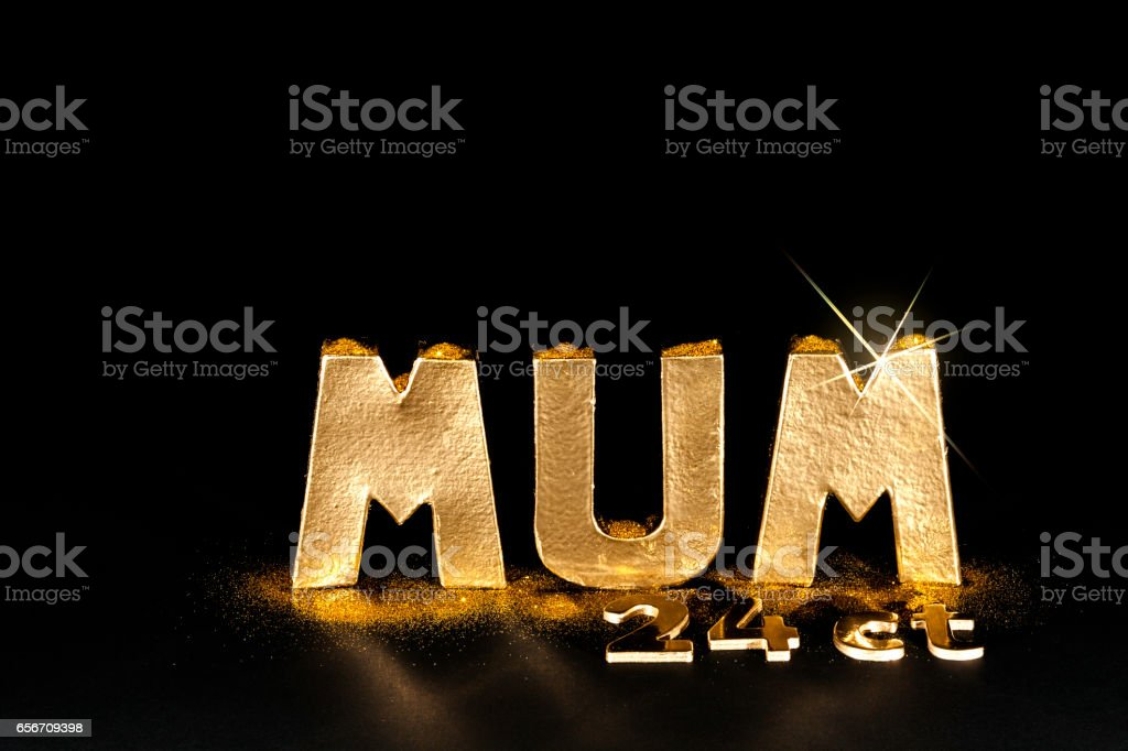 The word MUM. Worth her weight in 24ct gold. stock photo