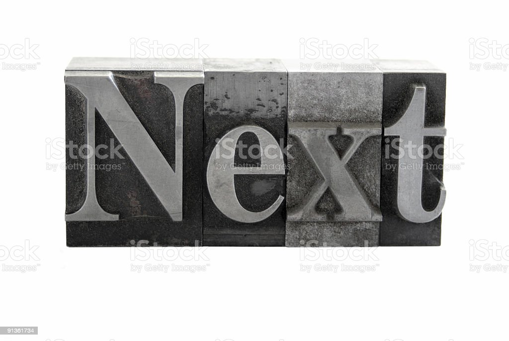 the word 'Next' in old metal letterpress type royalty-free stock photo