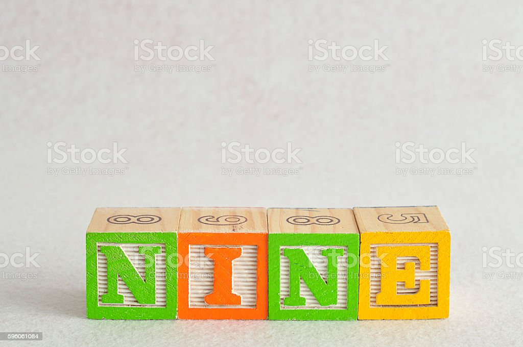 The word nine (9) spelled with colorful alphabet blocks royalty-free stock photo