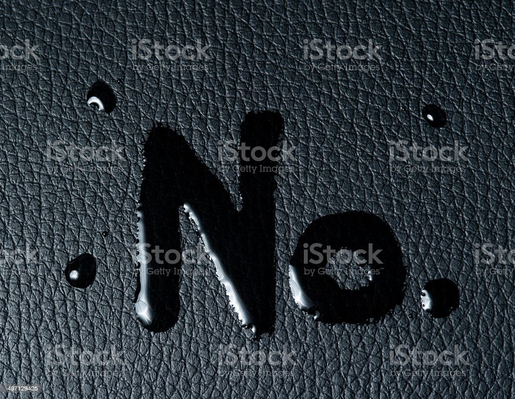 The word 'no' on black skin royalty-free stock photo