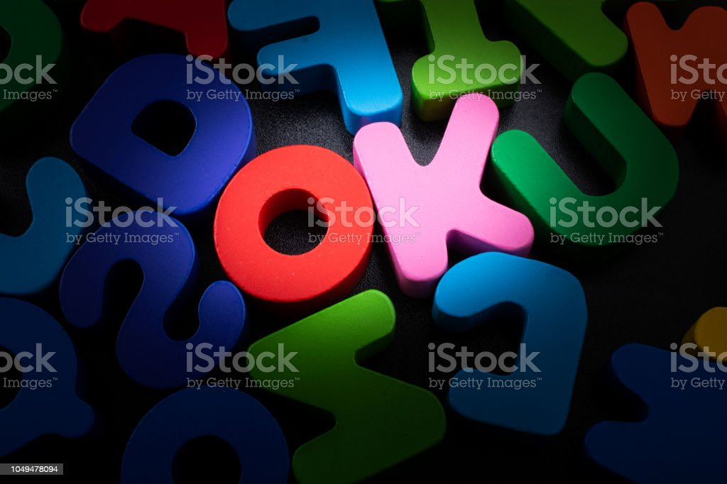 the word OK written with colorful letters the word OK written with colorful letter blocks Accuracy Stock Photo