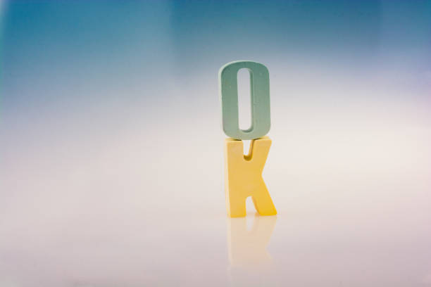 the word OK written with letter blocks the word OK written with colorful letter blocks admissible stock pictures, royalty-free photos & images
