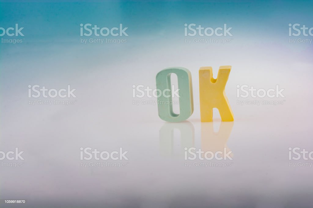 the word OK written with letter blocks the word OK written with colorful letter blocks Agreement Stock Photo