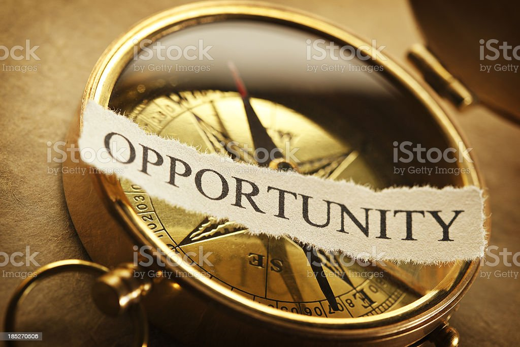 The word opportunity on a golden compass royalty-free stock photo