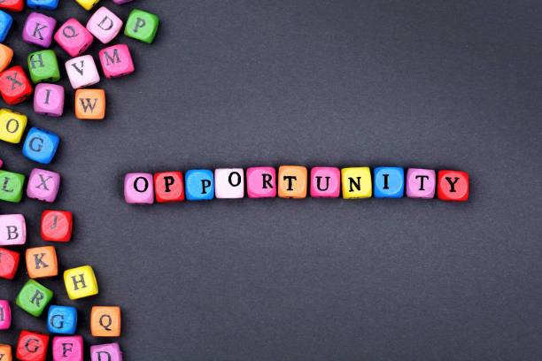 the word opportunity on black background - opportunity stock photos and pictures