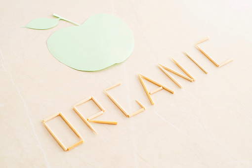 istock The word organic and abstract green apple on beige background 534191186