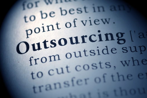 The Word Outsourcing In The Dictionary Stock Photo - Download Image Now