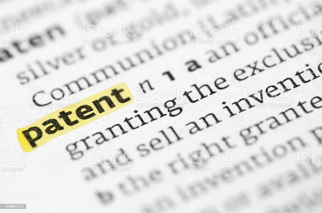 The word patent highlighted in a dictionary royalty-free stock photo