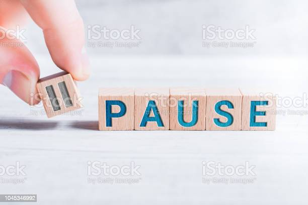 The word pause formed by wooden blocks and arranged by male fingers picture id1045346992?b=1&k=6&m=1045346992&s=612x612&h=4l8 tlr nob4pvqy4gfkewxi9fwfsykd9 vtuwajtsa=