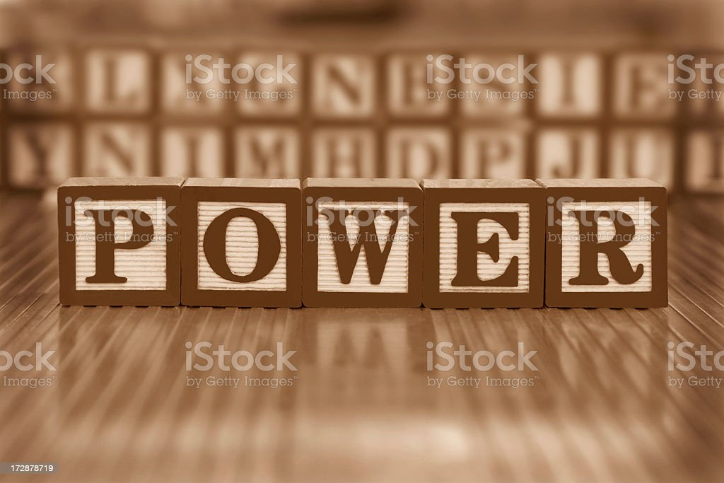 The word power spelled with letter blocks in sepia royalty-free stock photo