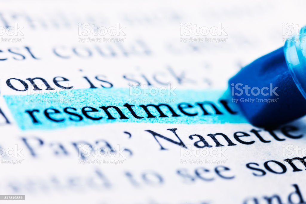 The word 'resentment' is highlighted in printed document stock photo
