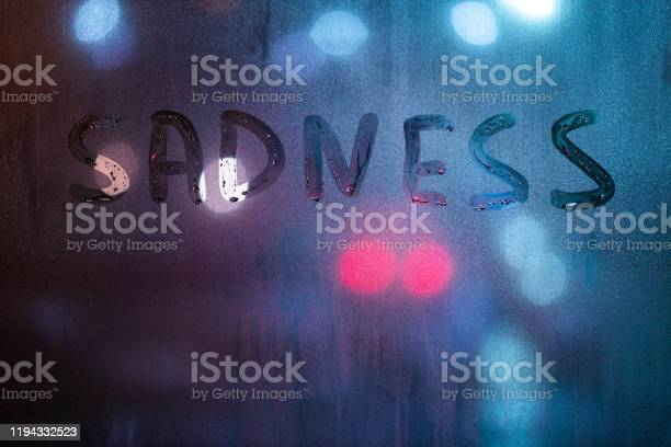 The word sadness written by finger on night wet glass with blurred picture id1194332523?b=1&k=6&m=1194332523&s=612x612&h=apiuzwwsbfjd4zkllugxd57ash  regzl1uumvgab9o=
