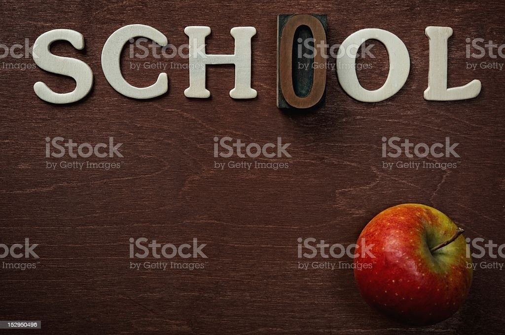 The word school written on wooden background royalty-free stock photo