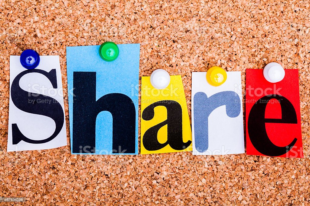 The word Share in cut out magazine letters stock photo
