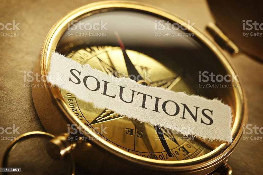 The word solution on a golden compass royalty-free stock photo